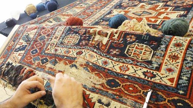 Oriental Rug Clinic repairing an Oriental rug