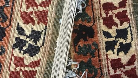 Rug in the process of being repaired and restored